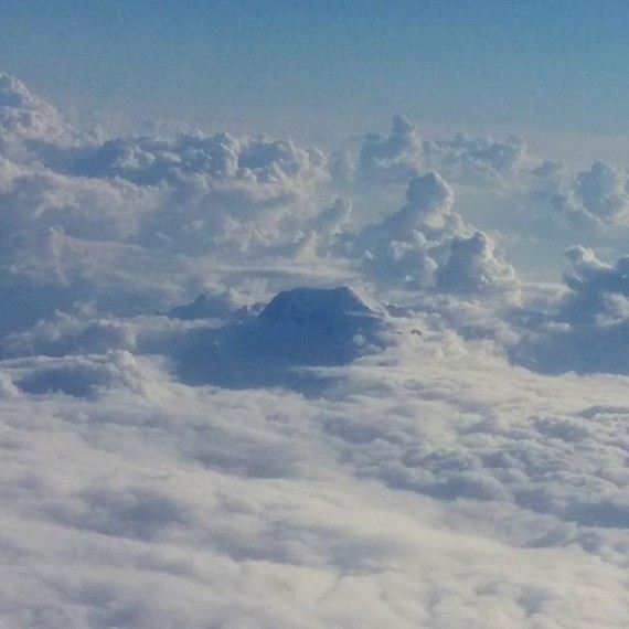 Flying back from meeting in Milan. That's a mountain poking through the clouds! #cloudtoparchipelago #alps