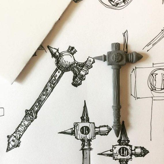 Iron Hammer sculpture and sketches. For upcoming logo photo shoot. #miniaturesculpting #dungeonsanddragons #oldhammer #warhammer #fantasyart #sketching #penandink #greenstuff #sketchbook