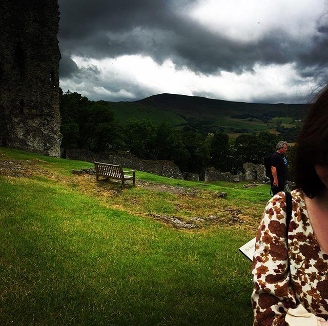 Caroline at Peveril castle with tiny stranger on shoulder.